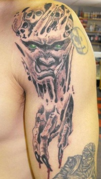 Demon skin rip tattoo