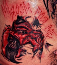 Devil skin rip tattoo