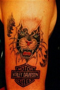 Skin rip panther tattoo